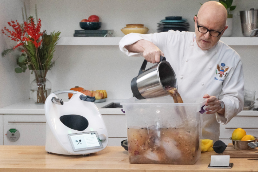 Chef Bill Yosess brining a Thanksgiving turkey with his Thermomix by his side.