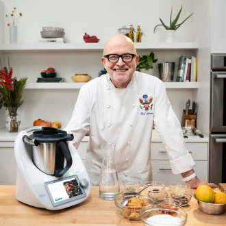 Chef Bill Yosses poses with his Thermomix.